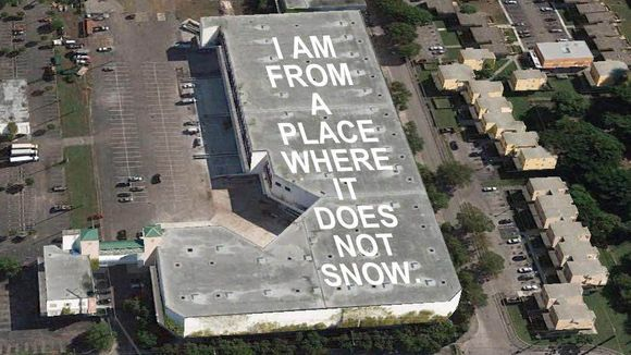 635967471540740766-Mock-up-of-the-poem-by-3rd-grader-Nieema-Marshall-being-painted-on-a-rooftop-near-Miami-International-Airport